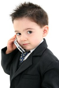 Adorable Baby Boy in Suit on Cellphone
