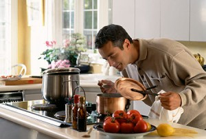 Man cooking, smelling aroma   Original Filename: 200357416-001.jpg